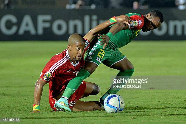 Congo's defender Marvin Baudry challenges Burkina Faso's midfielder Abdou Razack Traore during the 2015 African Cup of Nations group A football match...