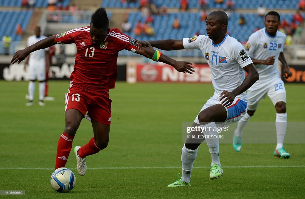 Congo's forward Bifouma Thievy (L) vies with Democratic Republic of the Congo's defender <a gi-track='captionPersonalityLinkClicked' href=/galleries/search?phrase=Cedric+Mongongu&family=editorial&specificpeople=4305033 ng-click='$event.stopPropagation()'>Cedric Mongongu</a> during the 2015 African Cup of Nations quarter final football match between Congo and Republic of the Congo in Bata, on January 31, 2015. AFP PHOTO / KHALED DESOUKI