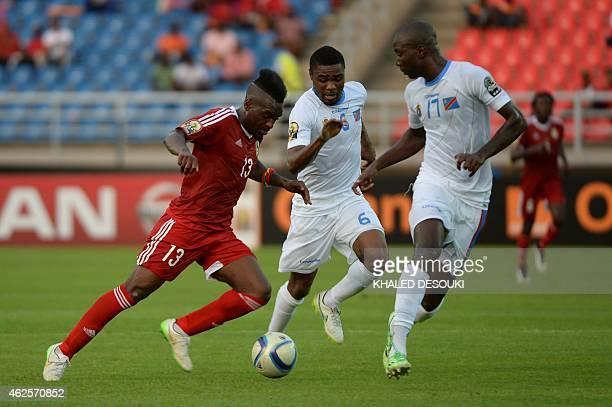 Congo's forward Bifouma Thievy vies with Democratic Republic of the Congo's midfielder Cedric Makiadi and Democratic Republic of the Congo's defender...
