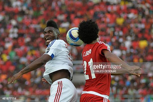 Congo's forward Thierry Bifouma jumps to head the ball with Equatorial Guinea's midfielder Ivan Zarandona during the 2015 African Cup of Nations...