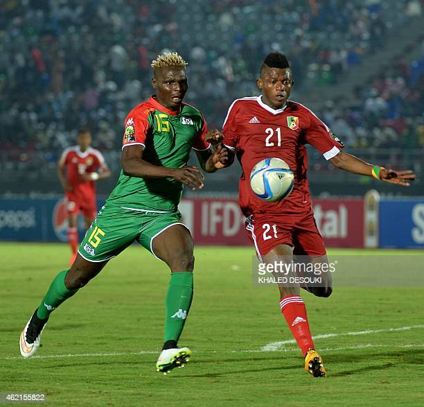 Congo's midfielder Sagesse Babele challenges Burkina Faso's forward Aristide Bance during the 2015 African Cup of Nations group A football match...
