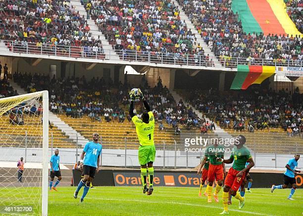 DR Congo's Muloko Kudimbana stops the ball during their friendly football match against Cameroon in Yaounde Ahmadou Ahidjo Stadium on January 7 prior...