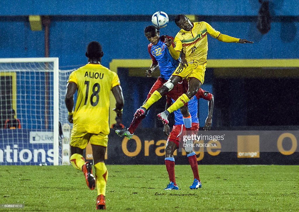 DR Congo's Yannick Bangala (2nd L) and Mali's Mamadou Coulibaly( R) vies for the ball during the African Nations Championship (CHAN) football final match between DR Congo's Leopards and Mali's Eagles on February 7, 2016 in Kigali. / AFP / CYRIL NDEGEYA