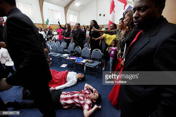 Congregants are overcome with emotion as they pray and sing Gospel tunes during a church worship service at the True Love Worship Center in Van Nuys...