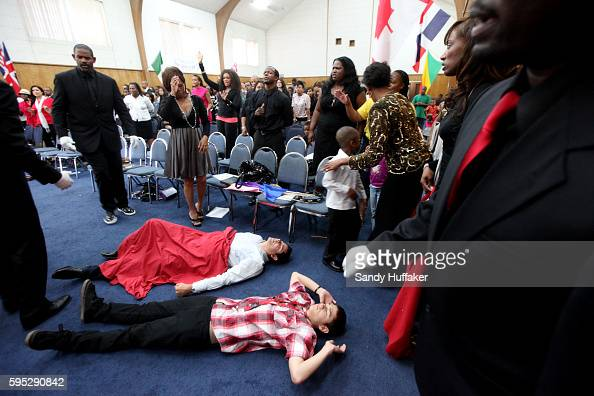 Congregants are overcome with emotion as they pray during a worship service at the True Love Worship Center in Van Nuys CA on Sunday July 31 2011