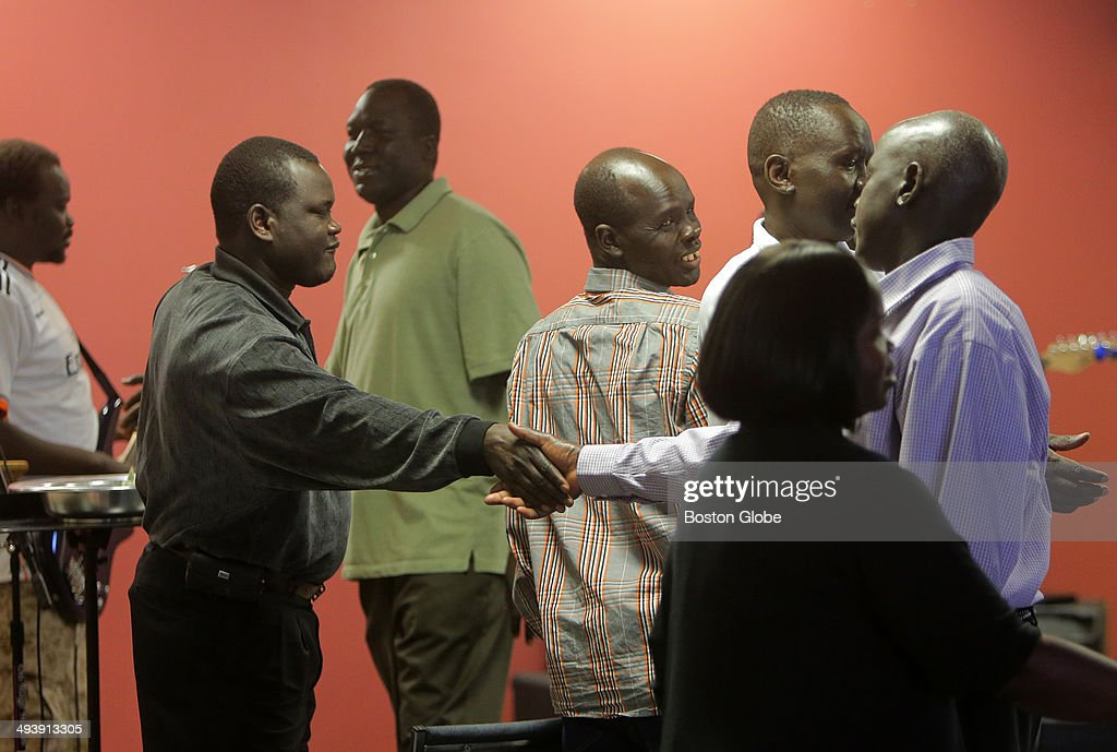 Congregants greet each other after the service at the Sudanese Evangelical Covenant Church. Imprisoned in Sudan, pregnant wife of New Hampshire resident Daniel Wani, Merian Yahia Ibrahim Ishaq, is condemned to hanging for not recanting her Christian faith.