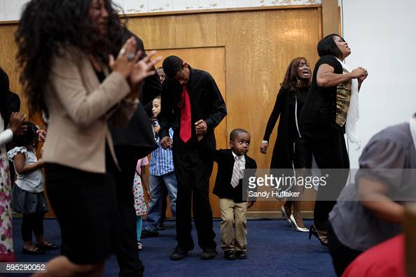 Congregants pray and sing Gospel tunes during a worship service at the True Love Worship Center in Van Nuys CA on Sunday July 31 2011