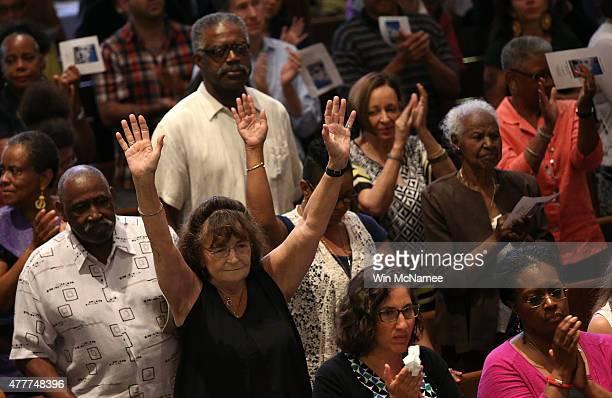 Congregants pray during a prayer vigil for the nine victims killed at the Emanuel African Methodist Episcopal Church in Charleston South Carolina at...