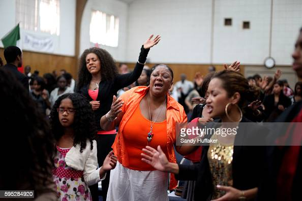 Congregants pray during a worship service at the True Love Worship Center in Van Nuys CA on Sunday July 31 2011