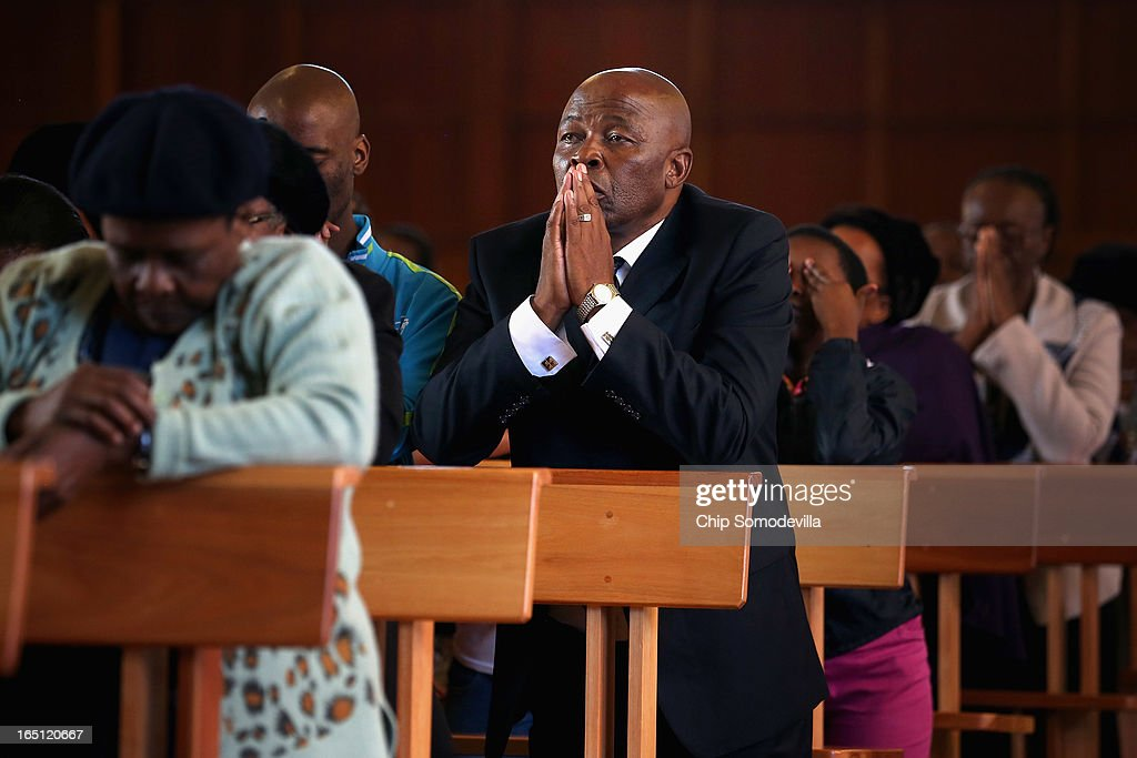 Congregants pray during Easter services at Regina Mundi Catholic Church in the Soweto area March 31, 2013 in Johannesburg, South Africa. A central gathering place during he anti-apartheid struggle, the church held prayers for former South African President Nelson Mandela, 94, who is in the hospital for the third time since December with lung problems. Referring to Mandela by clan name, Madiba, President Jacob Zuma said, 'We appeal to the people of South Africa and the world to pray for our beloved Madiba and his family and to keep them in their thoughts.' Mandela's lungs were damaged when he contracted tuberculosis during his 27 years in the infamous Robben Island prison. Mandela became the nation's first democratically elected president in 1994 following the end of apartheid.