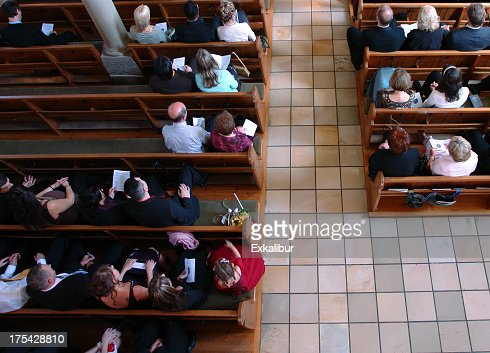 Congregation at church praying