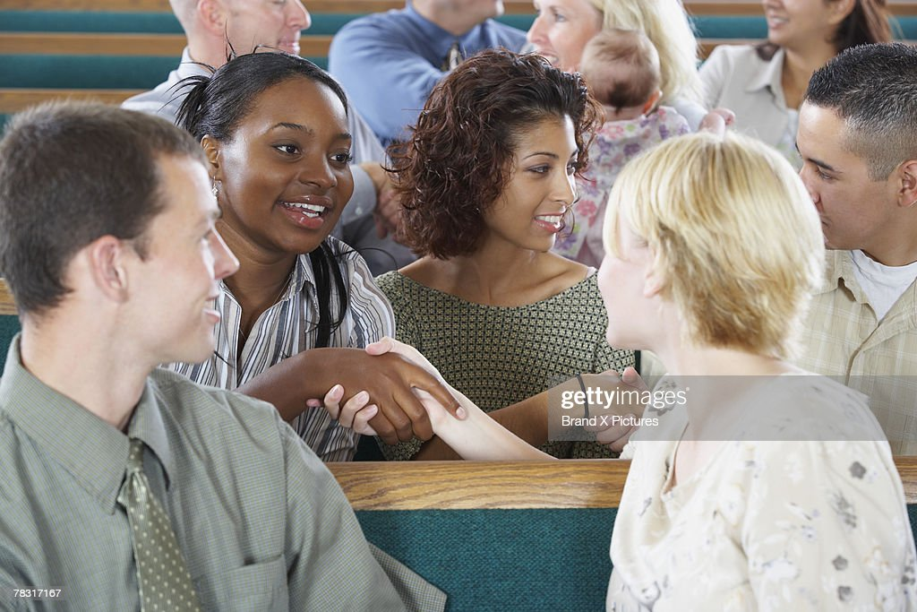 Congregation greeting each other in church