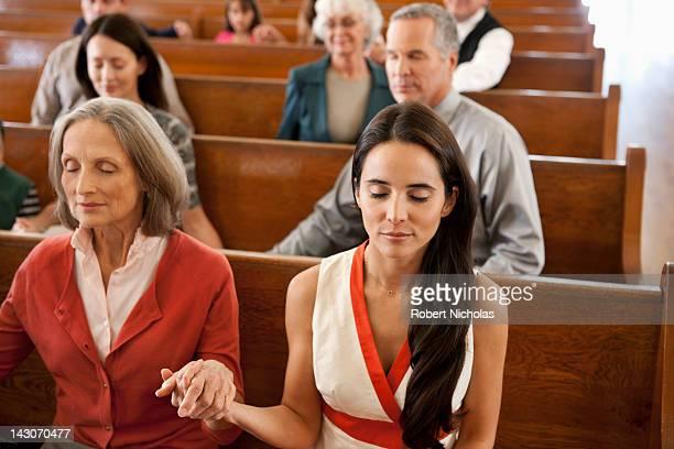 Congregation holding hands in prayer