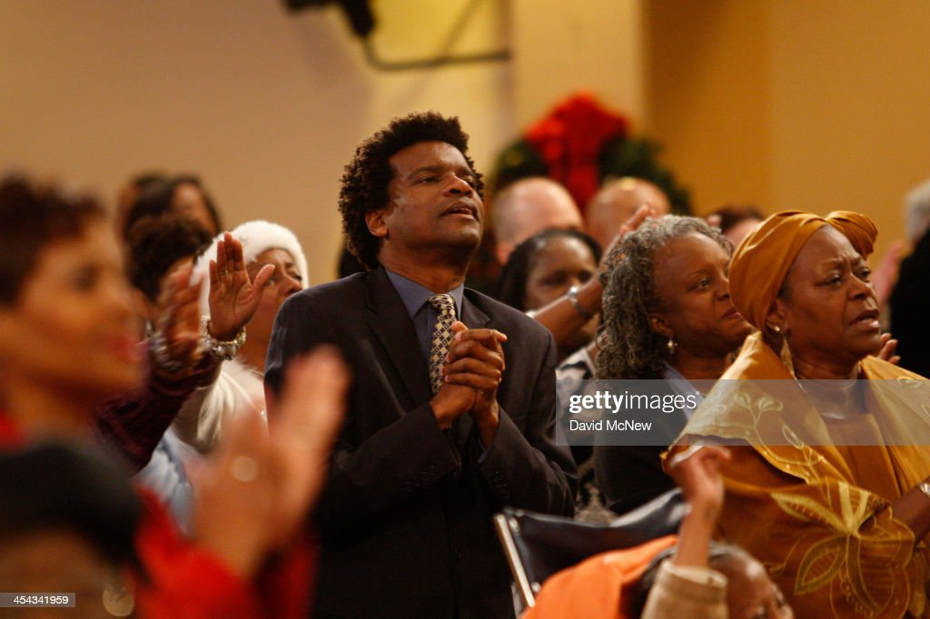 Congregation members worship at service to honor the late South African President and anti-apartheid leader Nelson Mandela, at the First AME Church on December 8, 2013 in Los Angeles, California. First AME Church of Los Angeles was the first stop on Nelson Mandela's visit to the U.S. after he was freed from prison. Mandela died on December 4 at the age of 95.