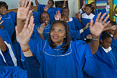 Congregation of Gospel Singers With Raised Hands Singing in a Church Service