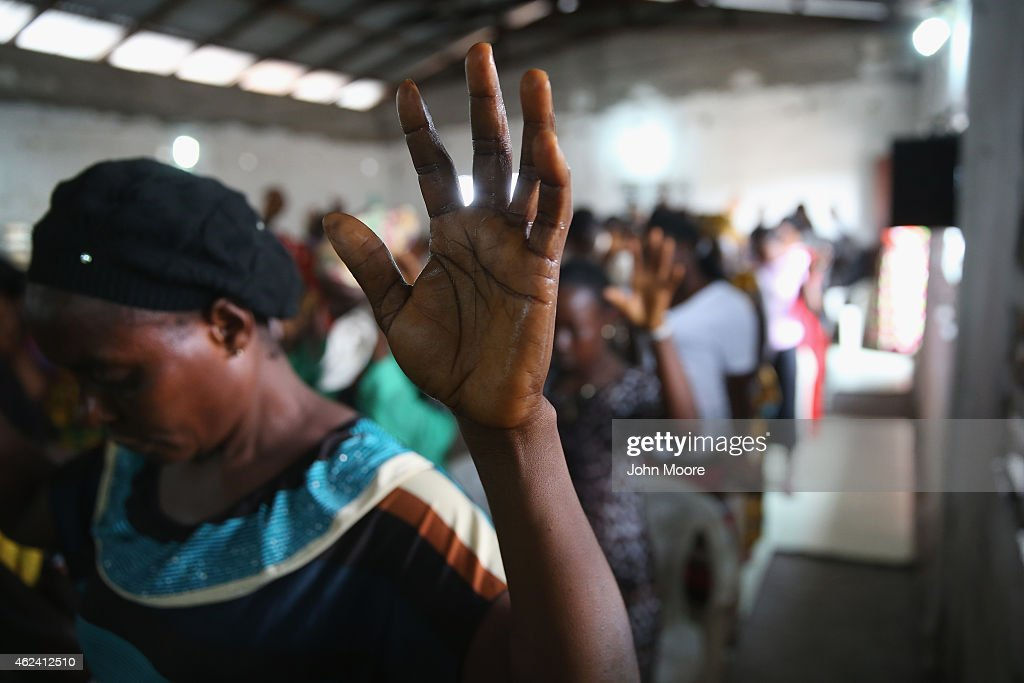A congregation prays during a Sunday service at the Bethel World Outreach Church in the West Point township on January 25 2015 in Monrovia Liberia...