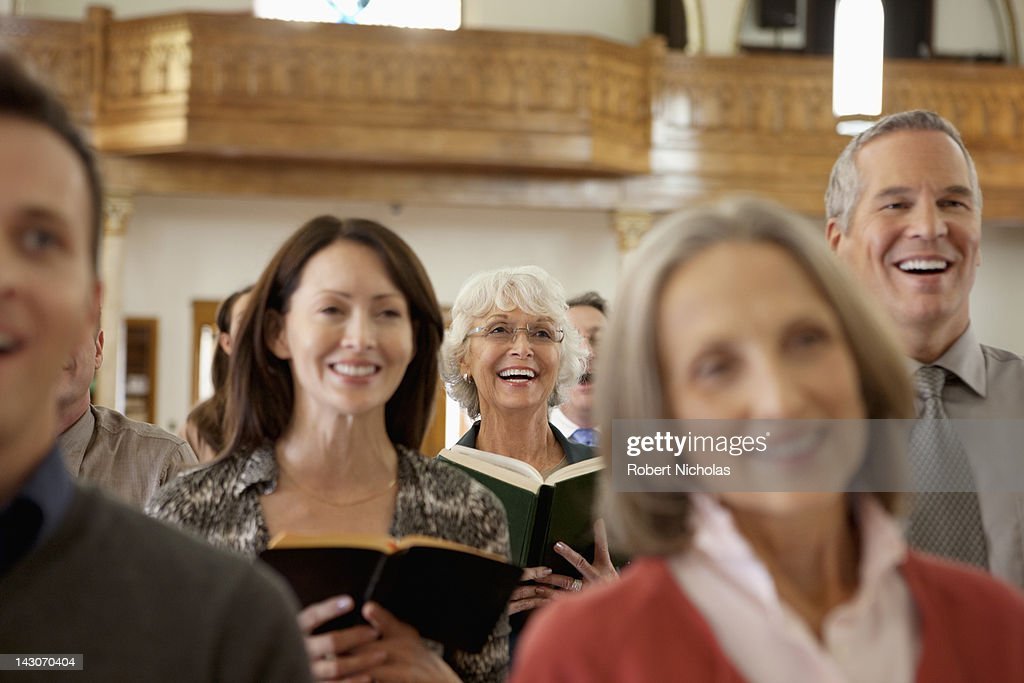 Congregation singing together in church : Stock Photo