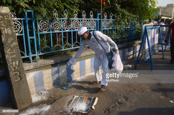 Congress activist spreads bleaching powder in the streets as a protest against the state government for spreading the dengue in Kolkata India on...