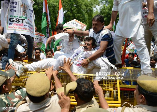Congress activists during the gherao of the Parliament House to protest against the Goods and Services Tax claiming that the implementation of the...