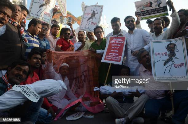 Congress activists holds poster against the state government for spreading the dengue during the protest rally in Kolkata India on Friday 3rd...