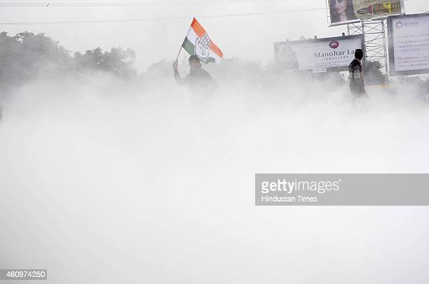 Congress activists protested and burnt effigy of Prime Minister Narendra Modi at DND toll against the ordinance to amend the Right to Fair...