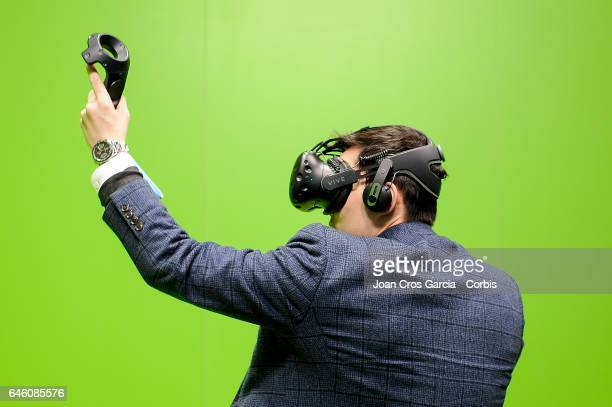 A congress attendee plays with HTC Vive during the Mobile World Congress on February 27 2017 in Barcelona Spain