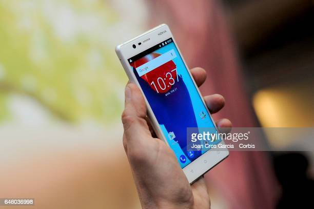 A congress attendee tests the new Nokia 3 during the Mobile World Congress on February 27 2017 in Barcelona Spain