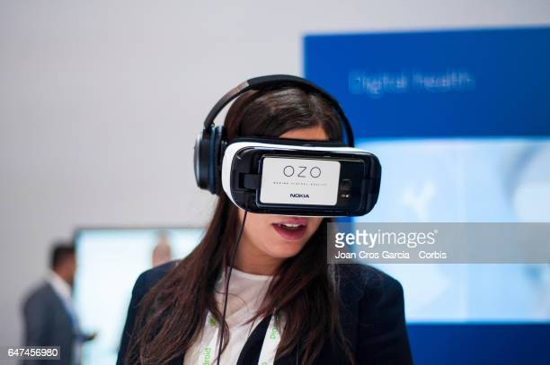 A congress attendee using the Samsung VR to watch a video recorded with the Nokia OZO 360º camera during the Mobile World Congress on March 2 2017 in...