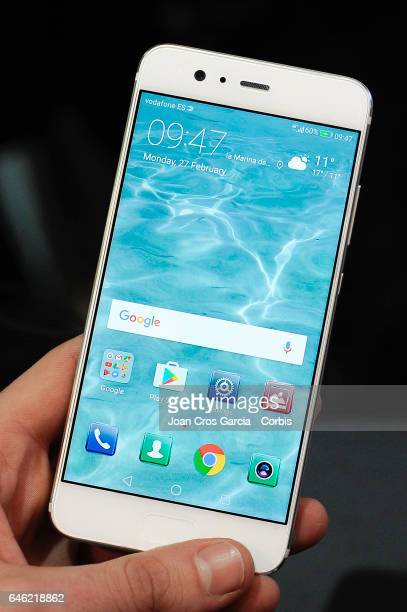 Congress attendees test the new Huawei P10 during the Mobile World Congress on February 27 2017 in Barcelona Spain