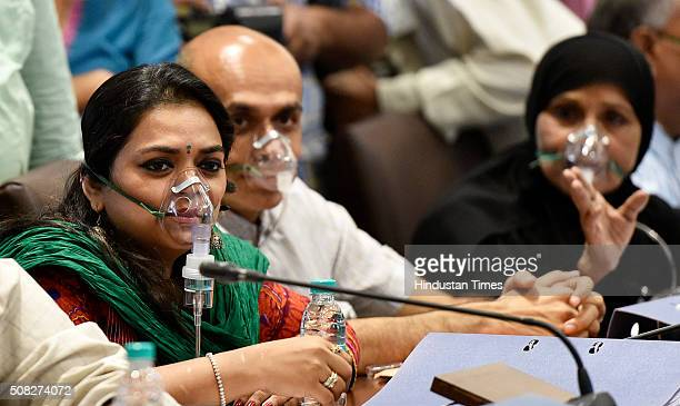 Congress corporators wear oxygen masks during the BMC's budget session to protest against the pollution caused by the Deonar dumping ground fire at...