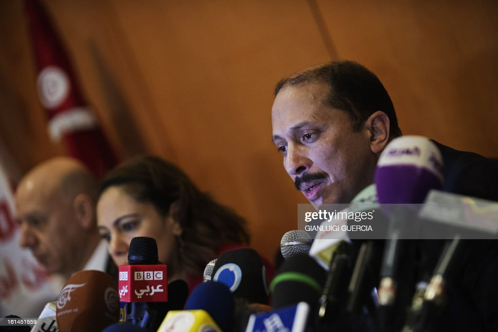 Congress for the Republic Secretary General Mohamed Abbou (R) gestures during a press conference on February 11, 2013 in Tunis in which he said Tunisian President Moncef Marzouki' secular party would stay in the coalition government, pending the resignation of key ministers from the ruling Islamist party. AFP PHOTO/GIANLUIGI GUERCIA