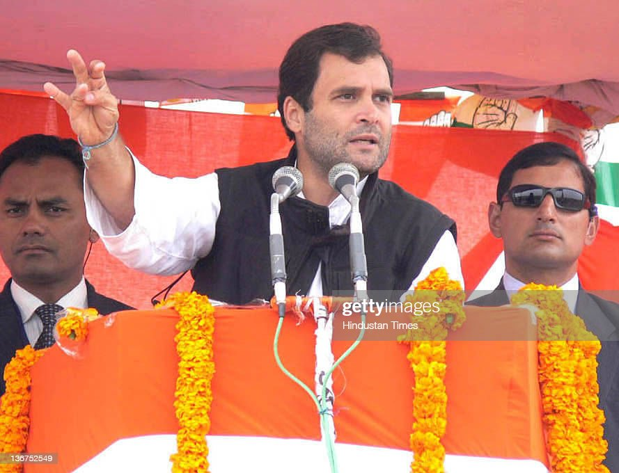 Congress General Secretary <a gi-track='captionPersonalityLinkClicked' href=/galleries/search?phrase=Rahul+Gandhi&family=editorial&specificpeople=171802 ng-click='$event.stopPropagation()'>Rahul Gandhi</a> addresses the crowd at a public meeting on January 11, 2012 in Azamgarh, India. In Ghandi's speech he attacked Mulayam Singh Yadav, saying that the Samajwadi Party Chief has joined hands with those who demolished the Babri Masjid.