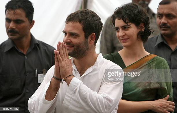 Congress General Secretary Rahul Gandhi and Priyanka Gandhi during the distribution of motorized triwheelers to disabled persons on the occasion of...