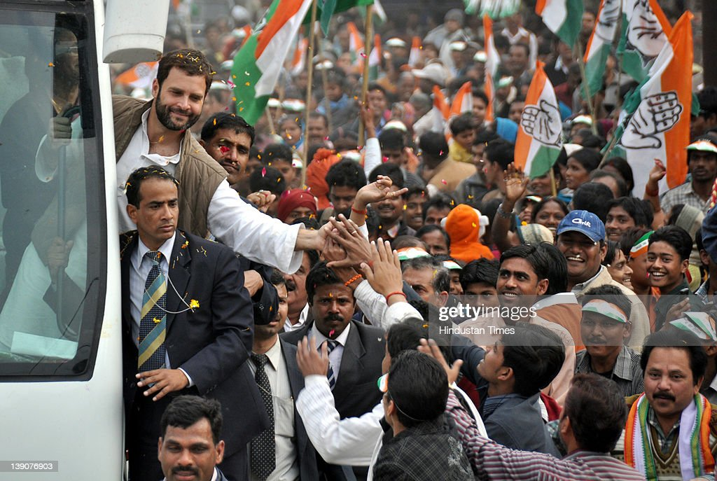 Congress general secretary <a gi-track='captionPersonalityLinkClicked' href=/galleries/search?phrase=Rahul+Gandhi&family=editorial&specificpeople=171802 ng-click='$event.stopPropagation()'>Rahul Gandhi</a> shakes hands with people during a road show on February 16, 2012 in Lucknow, India. Gandi undertook a 34 km long road show, in a specially designed bus, covering many assembly seats in the state capital.