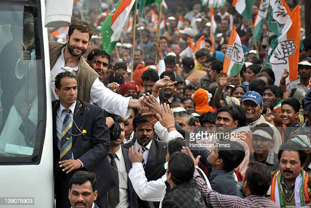 Congress general secretary Rahul Gandhi shakes hands with people during a road show on February 16 2012 in Lucknow India Gandi undertook a 34 km long...