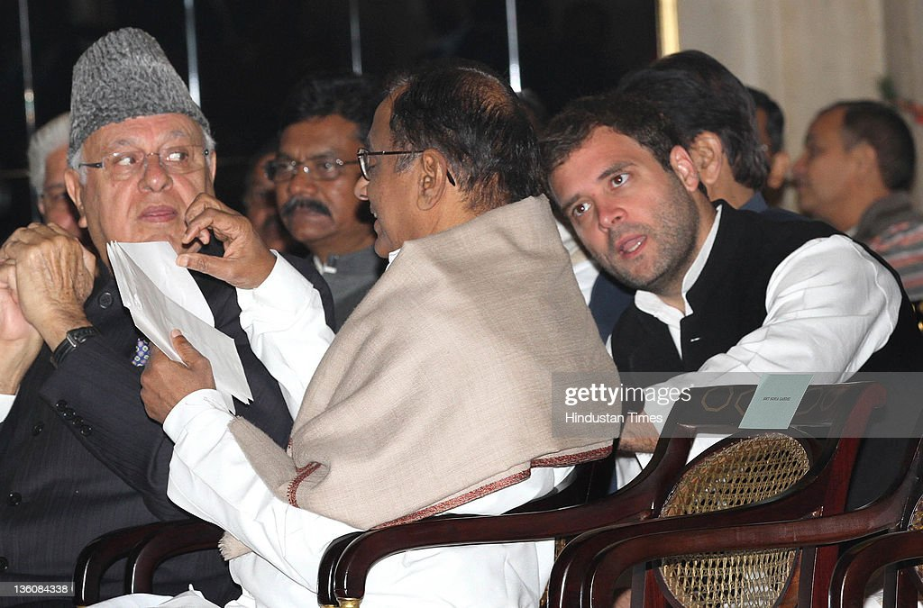 Congress General Secretary <a gi-track='captionPersonalityLinkClicked' href=/galleries/search?phrase=Rahul+Gandhi&family=editorial&specificpeople=171802 ng-click='$event.stopPropagation()'>Rahul Gandhi</a> talking with Union Home Minister P Chidambaram and <a gi-track='captionPersonalityLinkClicked' href=/galleries/search?phrase=Farooq+Abdullah&family=editorial&specificpeople=2291127 ng-click='$event.stopPropagation()'>Farooq Abdullah</a> (L) during swearing-in ceremony of new Union Cabinet Minister Ajit Singh at the Rashtrapati Bhawan on December 18, 2011 in New Delhi, India. Ajit Singh was given charge of Ministry of Civil Aviation.