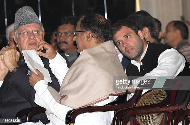 Congress General Secretary Rahul Gandhi talking with Union Home Minister P Chidambaram and Farooq Abdullah during swearingin ceremony of new Union...