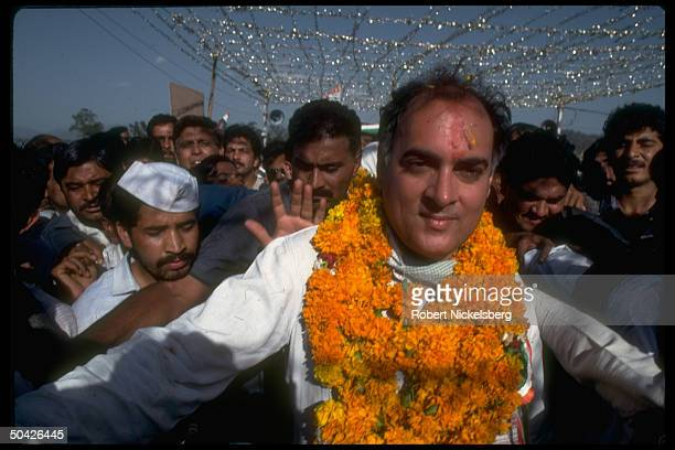 Congress ldr ex PM Rajiv Gandhi decked in garlands w supporters campaigning for May parliamentary election in Uttar Pradesh state