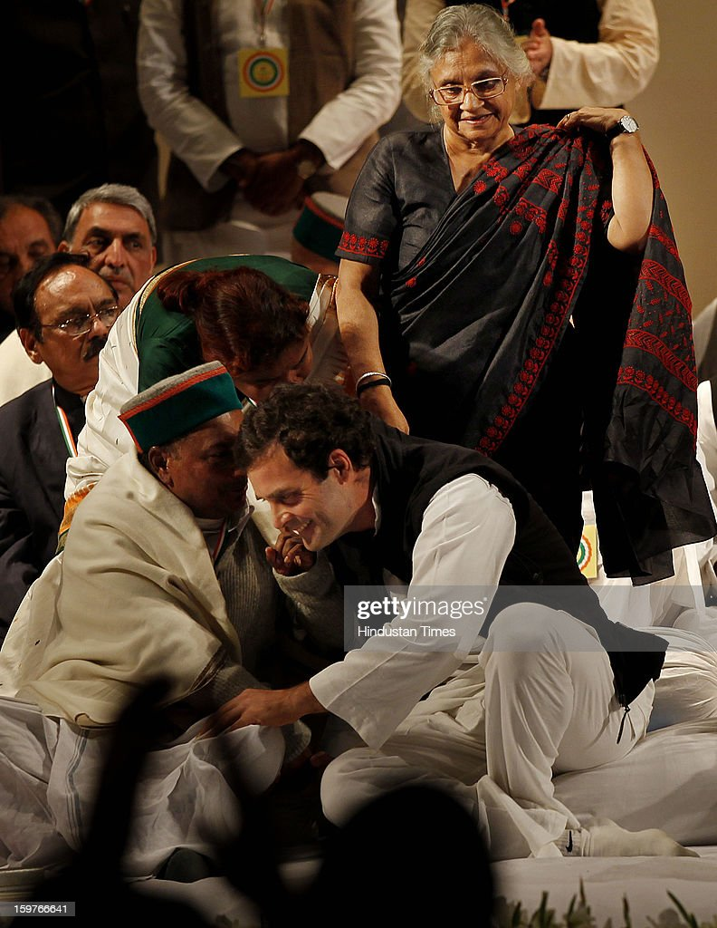 Congress leader A K Antony greets Congress Vice President Rahul Gandhi after his speech while Delhi Chief Minister Sheila Dikshit looks on during the AICC meeting after the two days 'Chintan Shivir' at Birla Auditorium, Jaipur on January 20, 2013 in Rajasthan, India.