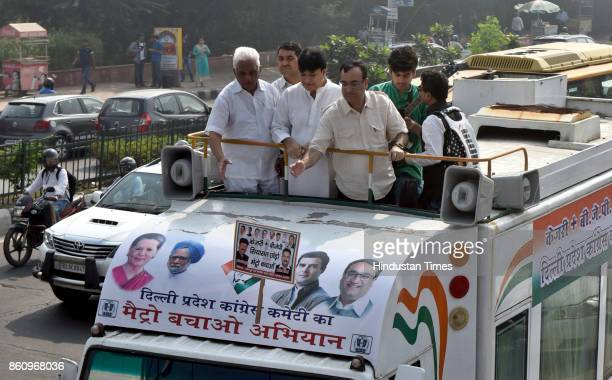 Congress leader Ajay Maken along with supporters protests against the hike in Metro Rail Fare at Akshardham Metro Station on October 13 2017 in New...