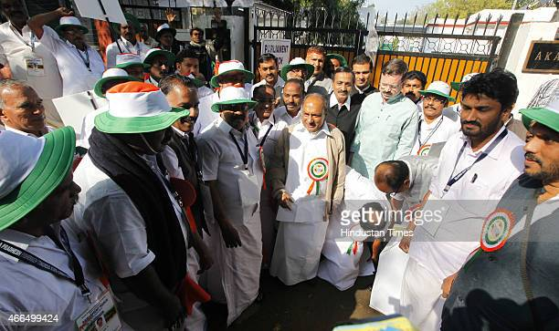 Congress leader AK Antony with his supporters protesting in favor of farmers and fishermen near Jantar Mantar on March 16 2015 in New Delhi India The...