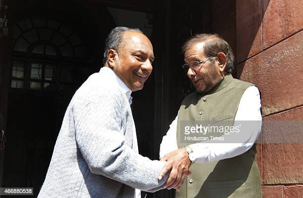 Congress leader AK Antony with JD Leader Sharad Yadav at Parliament House on March 19 2015 in New Delhi India Opposition forced deferment of...