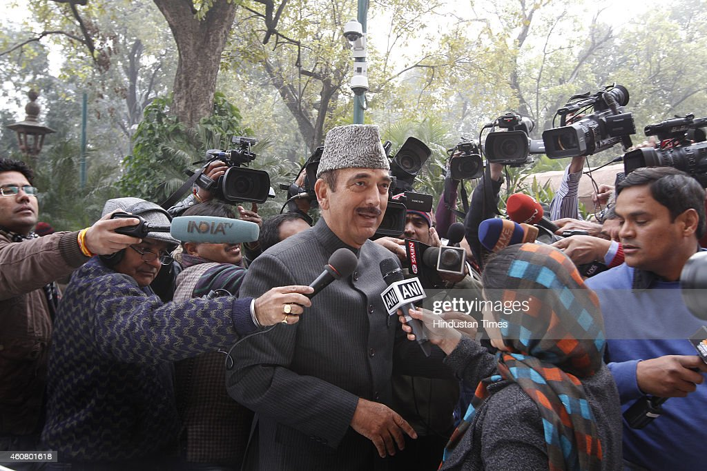 Congress Leader <a gi-track='captionPersonalityLinkClicked' href=/galleries/search?phrase=Ghulam+Nabi+Azad&family=editorial&specificpeople=772783 ng-click='$event.stopPropagation()'>Ghulam Nabi Azad</a> surrounded by media persons at Parliament House on last day of Parliament Winter Session on December 23, 2014 in New Delhi, India. The performance of the two houses stood in stark contrast as the month-long winter session of parliament concluded today with the Lok Sabha having passed a record 18 bills while the Rajya Sabha lost a majority of its working days to disruption.