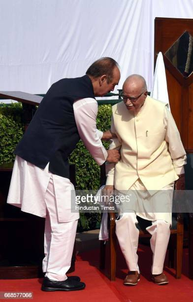 Congress leader Gulam nabi Azad help BJP Senior leader L K Adwani during floral tribute to Dr BR Ambedkar Parliament House on April 14 2017 in New...
