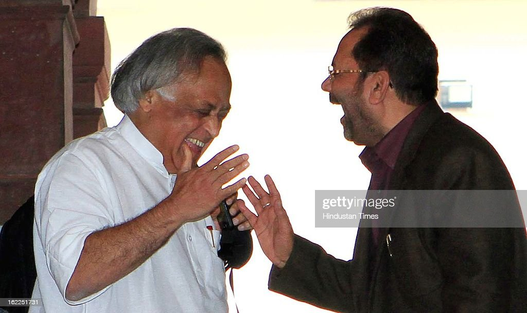 Congress leader Jairam Ramesh (L) and BJP leader Mukhtar Abbas Naqvi take light movements at Parliament during the opening day of Budget session on February 21, 2013 in New Delhi, India.