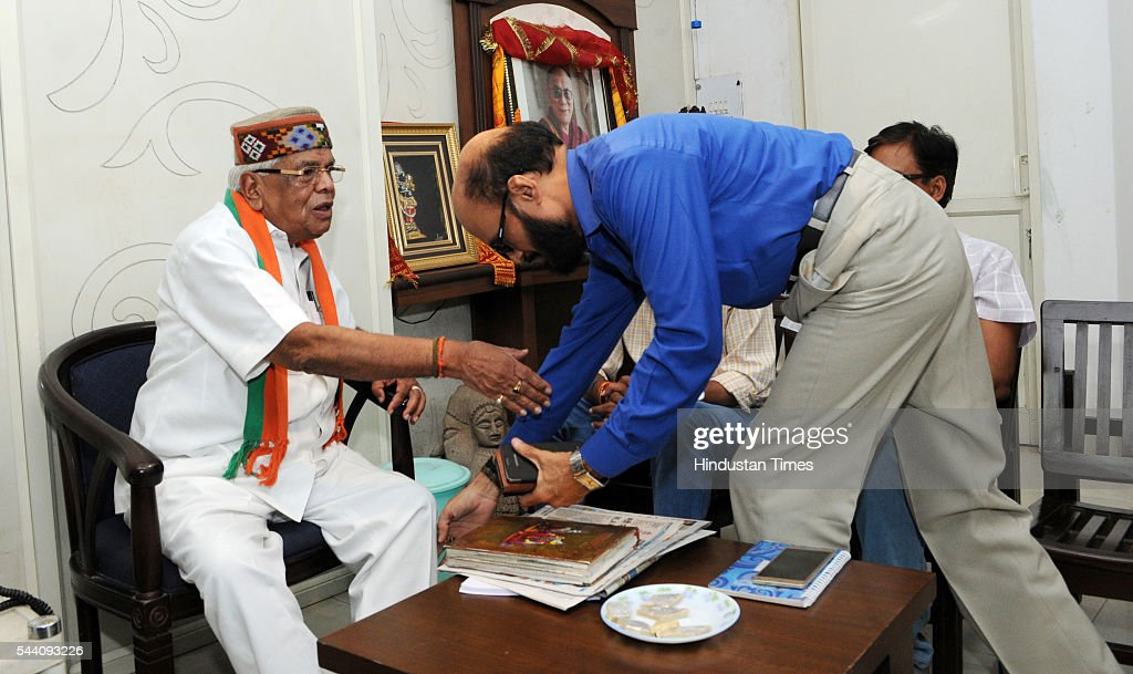 Congress leader KK Mishra taking blessings of Senior BJP Leader and former home minister Babulal Gaur on July 1, 2016 in Bhopal, India. 86-year-old Babulal Gaur, who was serving as Home Minister was dropped from Shivraj Singh Chouhan government owing to age bar of 75 years setup by PM Modi. Babulal Gaur is said to be not happy with this decision.