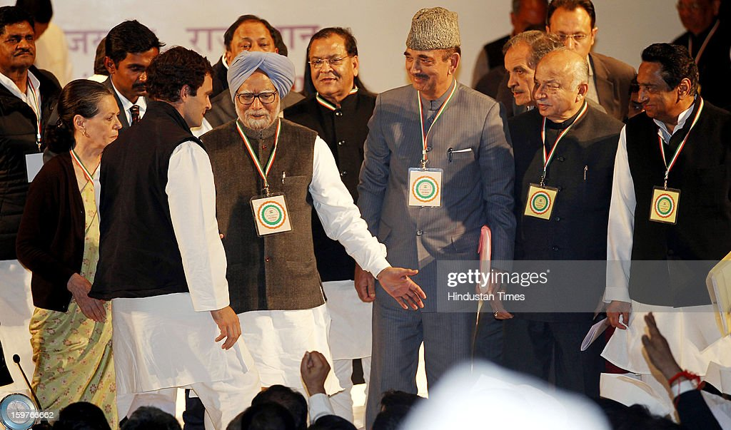 Congress leader Rahul Gandhi greets by Prime Minister Manmohan Singh while congress President Sonia Gandhi , Gulam Nabi Azad, Sushil Kumar Shinde and Kamal Nath looks on during the AICC meeting after the two days 'Chintan Shivir' at Birla Auditorium, Jaipur on January 20, 2013 in Rajasthan, India.