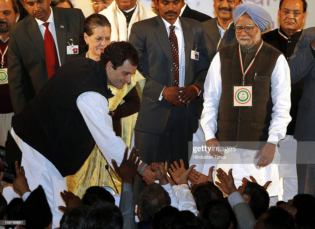 Congress leader Rahul Gandhi greets by the delegates while his mother and congress President Sonia Gandhi and Prime Minister Manmohan Singh looks on during the AICC meeting after the two days 'Chintan Shivir' at Birla Auditorium, Jaipur on January 20, 2013 in Rajasthan, India.