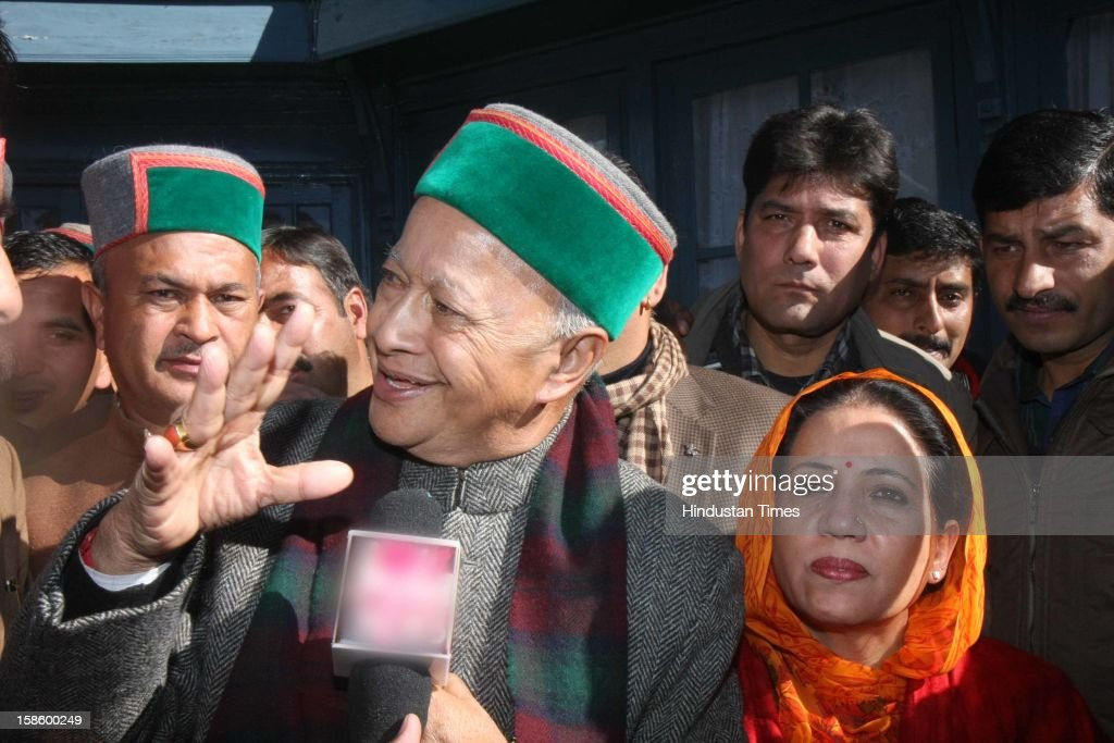 Congress leader Virbhadra Singh with wife Pratibha Singh after Congress Party declared winner in Himachal Pradesh State Assembly Poll 2012, on December 20, 2012 in Shimla, India. The opposition Congress drubbed the BJP in Himachal Pradesh assembly polls winning 36 out of 68 seats, while BJP got 26 seats.