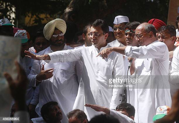 Congress leaders Digvijay Singh and Jitin Prasad addressing Youth Congress activists during Jan Akrosh Rally to protest against the alleged failure...